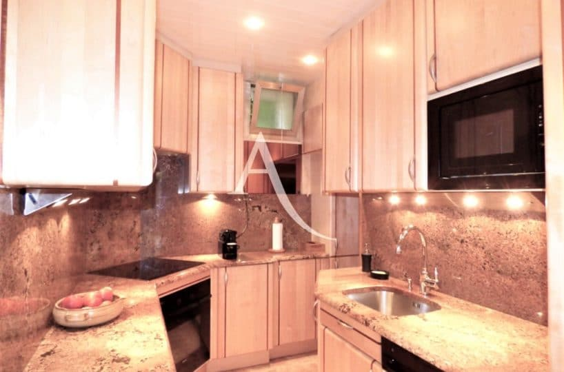 l adresse immobilier: 4 pièces 90 m², cuisine aménagée proche du salon