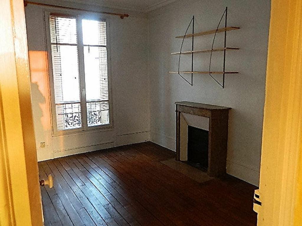 immobilier maison alfort: appartement 4 pièces 72 m², première chambre avec une cheminée