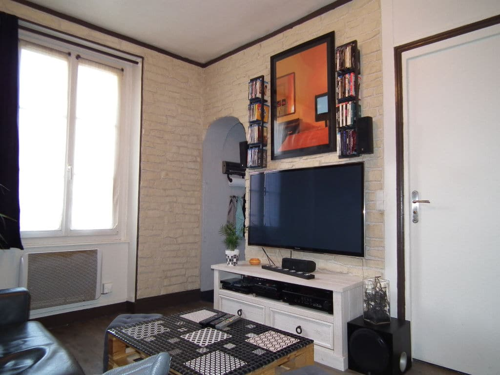 achat appartement alfortville: 2 pièces 29 m², séjour avec mur de briques