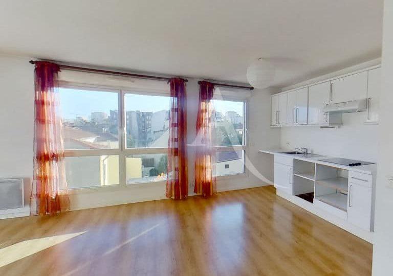l'adresse immobilier alfortville: studio 36 m², séjour avec coins cuisine américaine