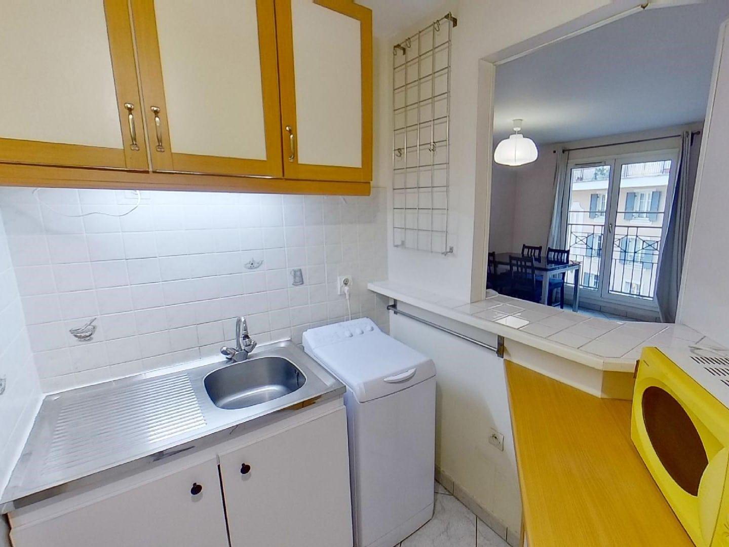 agence immobilière 94: 2 pièces 39 m², cuisine semi ouverte aménagée et équipée