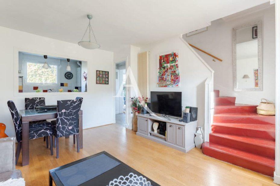 agence immo maisons alfort: 6 pièces 87 m², au rez-de-chaussée salon avec cuisine semi ouverte