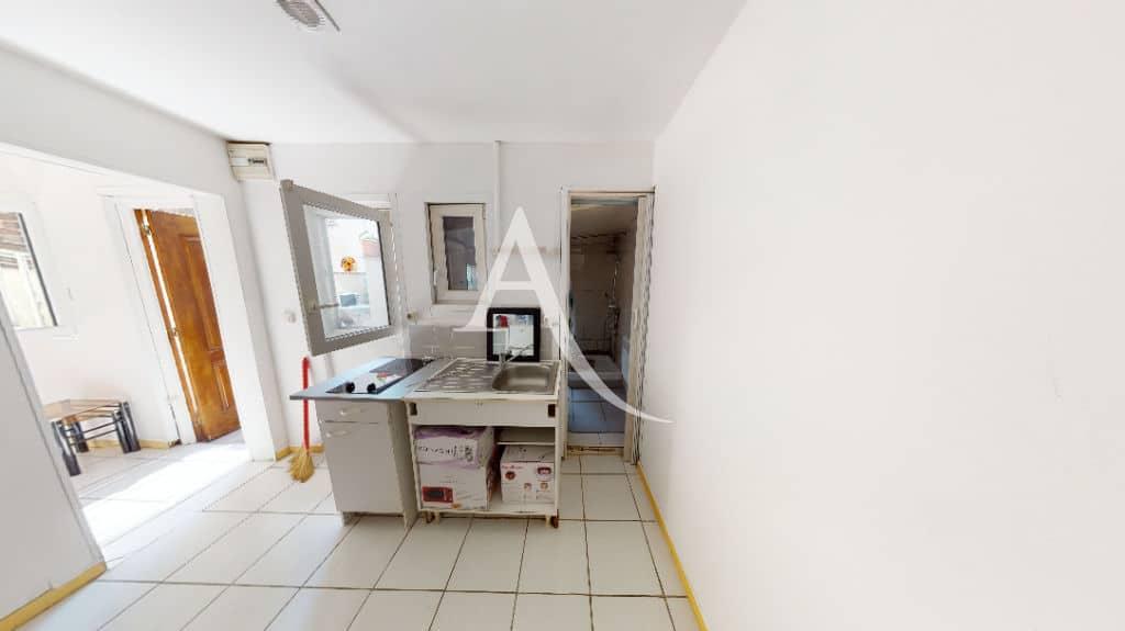 agence immo 94: 6 pièces 105 m², cuisine au 2° étage avec plaques de cuisson
