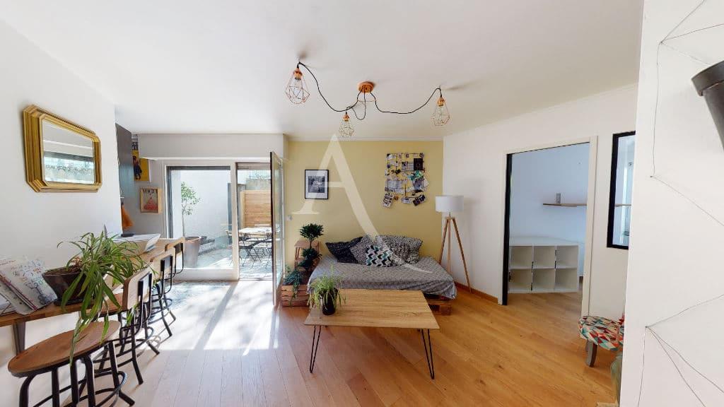 gerer agence immobiliere: 3 pièces 54 m², séjour avec terrasse, accès direct jardin